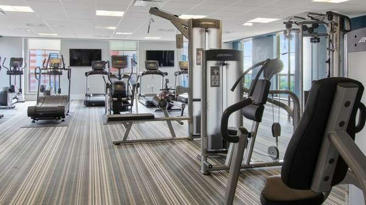 A full gym is part of the amenities at the apartment complex.