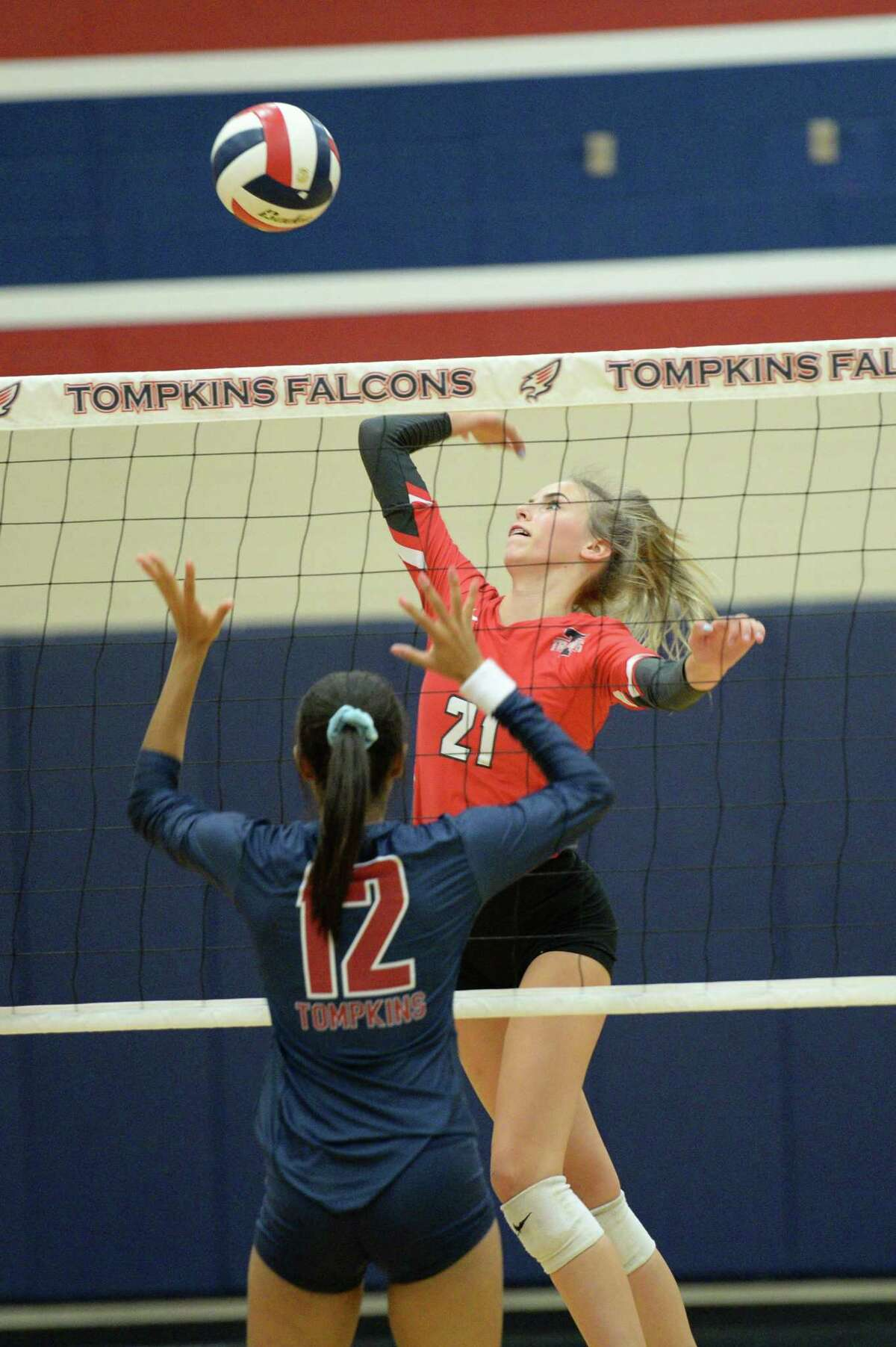 Taylor Glendening (21) of Travis attempts a shot during the first set of a volleyball match between the Tompkins Falcons and the Travis Tigers on Tuesday, August 6, 2019 at the Travis HS, Katy, TX.