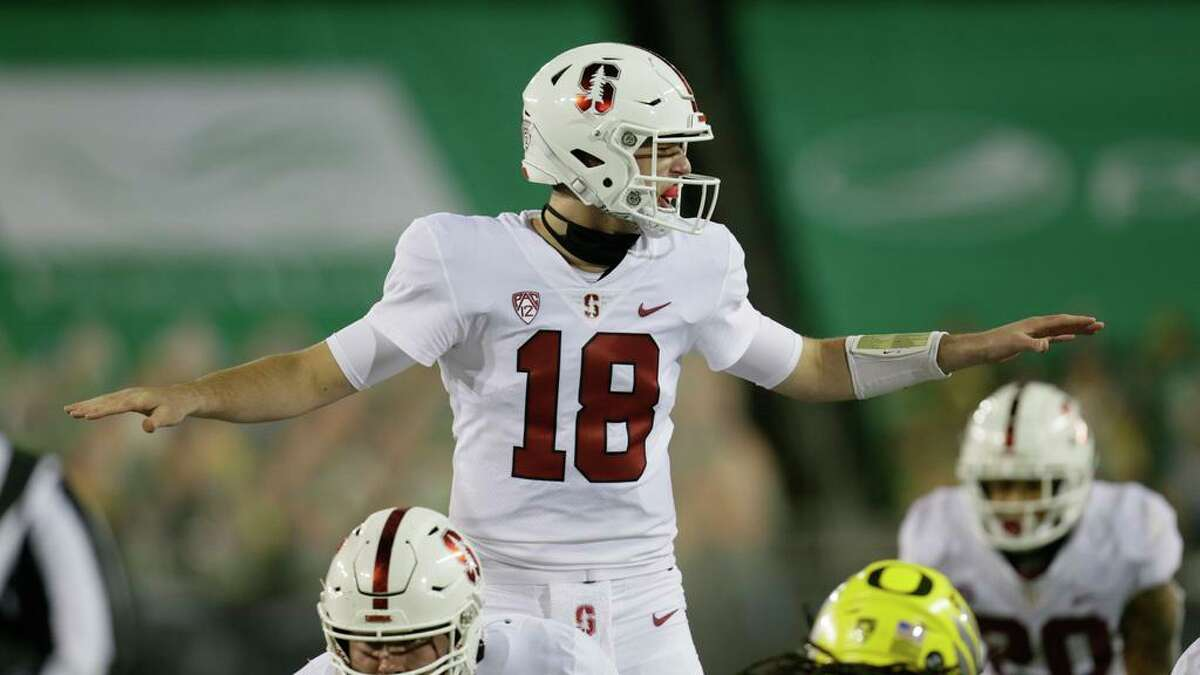 FILE- In this Nov. 7, 2020, file photo, Stanford's Tanner McKee calls out at the line of scimmage during an NCAA college football game in Eugene, Ore. Both senior Jack West and 6-foot-6 sophomore Tanner McKee will get snaps under center in their opener against Kansas State. West has played in five career games, McKee one. (AP Photo/Chris Pietsch, File)