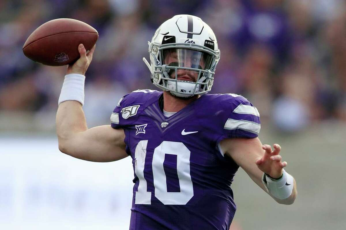 FILE - In this Nov. 16, 2019, file photo, Kansas State quarterback Skylar Thompson (10) passes to a teammate during the first half of an NCAA college football game against West Virginia in Manhattan, Kan. Quarterback Skylar Thompson is back for sixth year at K-State after a season-ending shoulder injury early last season. (AP Photo/Orlin Wagner, File)