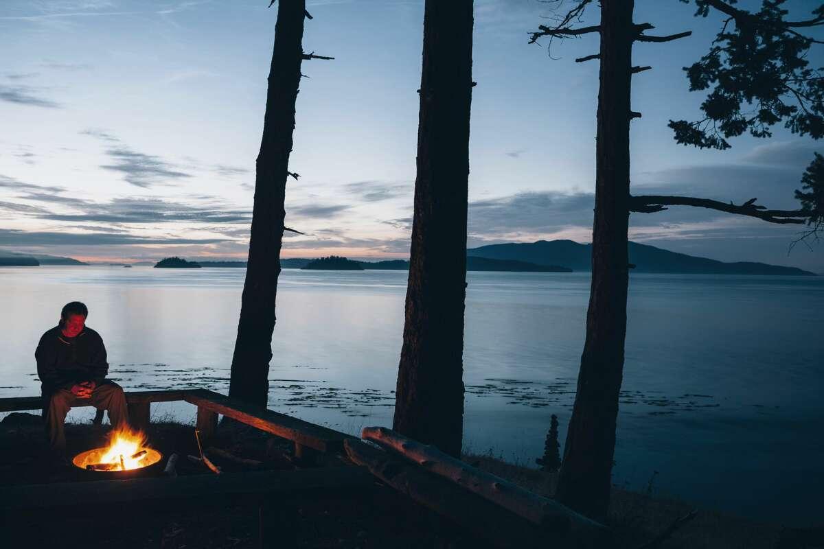 Man at a campfire in Washington.