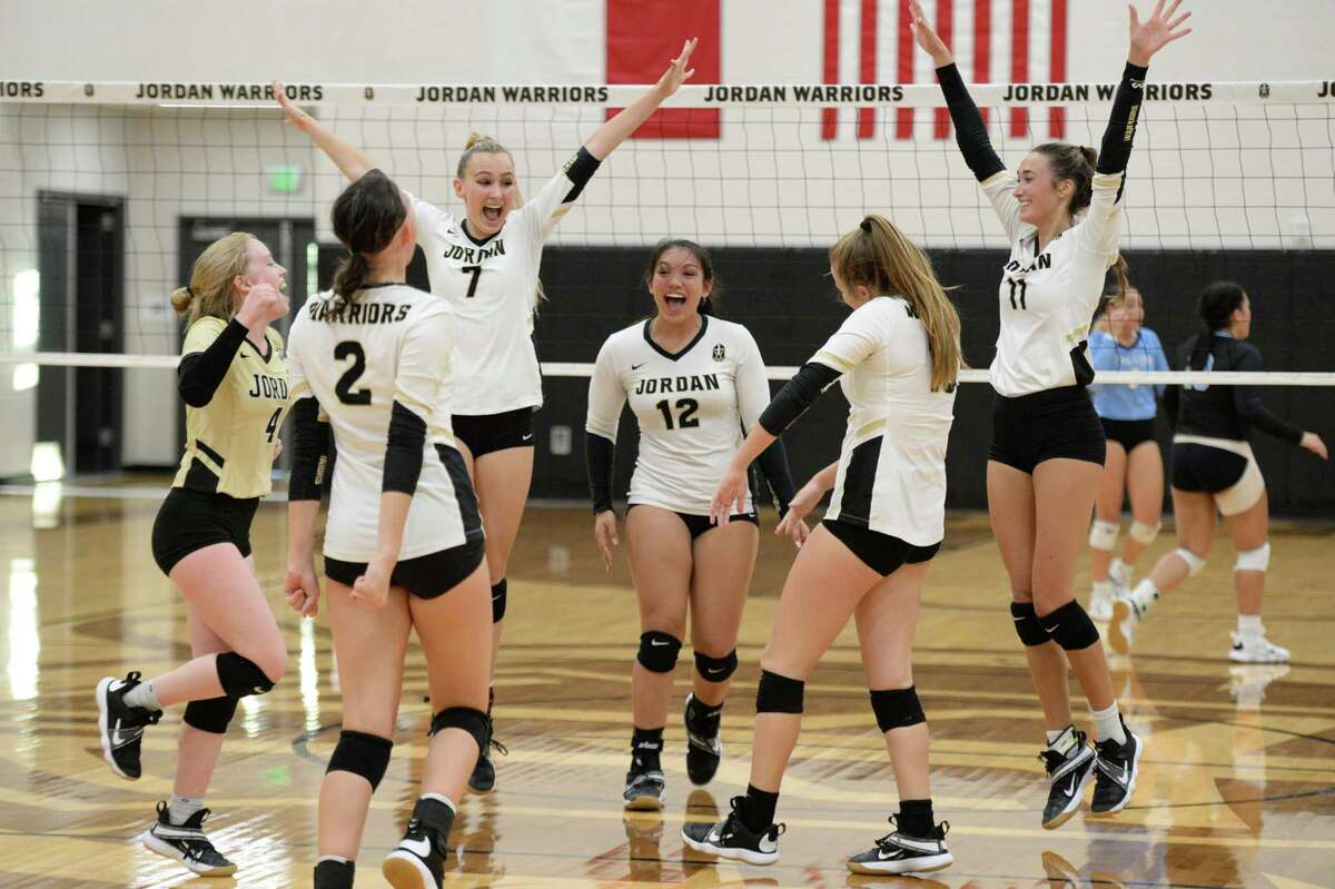 The Warriors celebrate a point during the second set of a 5A-III District 19 game between the Paetow Panthers and the Jordan Warriors on Tuesday, August 31, 2021 at Jordan High School, Fulshear, TX.