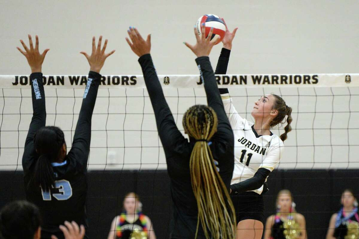 Ella Folse (11) of Jordan tries to hit a ball past Paetow defenders during the first set of a 5A-III District 19 game between the Paetow Panthers and the Jordan Warriors on Tuesday, August 31, 2021 at Jordan High School, Fulshear, TX.