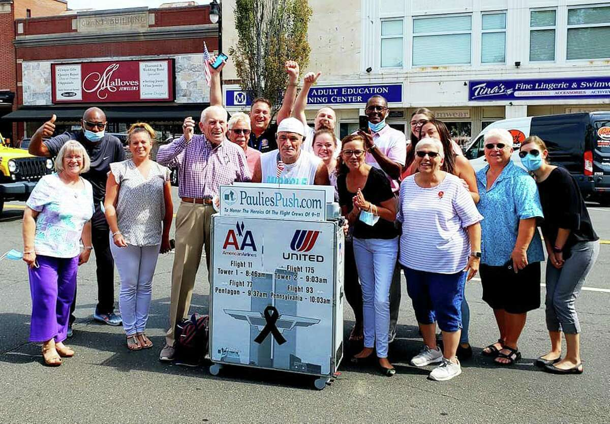"""Members of the Middlesex County Chamber of Commerce and Middletown Health Department thanked former flight attendant Paul """"Paulie"""" Veneto for pushing an airline beverage cart from Boston Logan International Airport to ground zero in New York City. His journey is a tribute to the flight attendants and crew members killed in the 9/11 attacks."""