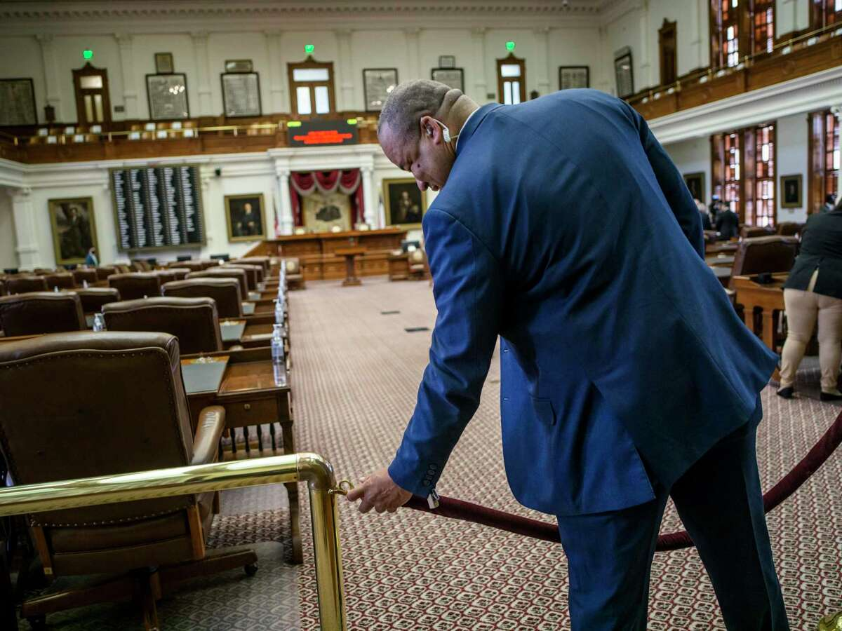 Doorkeeper to the Texas House of Representatives Anthony Hester cordons off the Texas House Floor after the second special session called by Governor Greg Abbott was quickly adjourned due to a lack of a quorum on Saturday, August 7, 2021 in Austin, Tx., U.S. The Texas House of Representatives did not have a quorum due to a number of Texas House Democrats being absent and adjourned quickly after opening the session on Saturday afternoon.