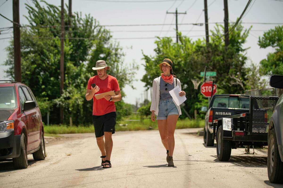 Volunteers Danielle Goshen and Ben Peters decide what street to walk down next as they block walk with the group Stop TxDOT I-45, Saturday, July 24, 2021, at an area along I-10 just east of downtown near Gregg Street that would be impacted by the Interstate 45 project in Houston. The group has been reaching out to neighbors in impacted areas spreading the word about their efforts to stop the current planned expansion of Interstate 45.