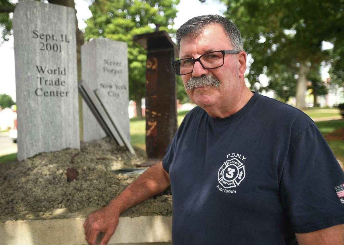 Fire commissioner and former Assistant Fire Chief Gary Parker by the 9/11 memorial on the Green in Derby, Conn. on Tuesday, Aug. 31, 2021. Parker participated on-scene in the rescue and recovery effort immediately following the 9/11 attacks.