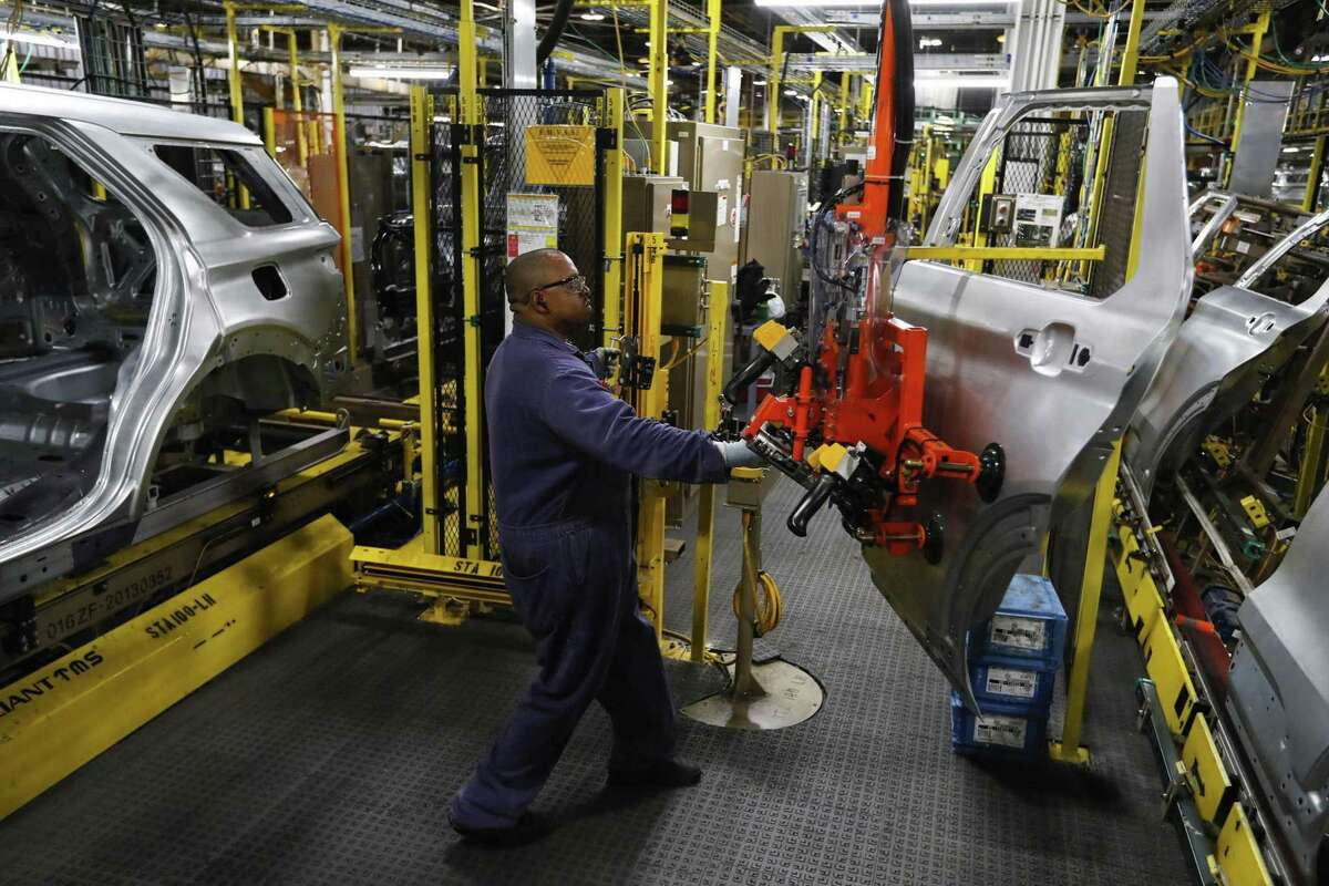 Workers on a Ford assembly line in Chicago in 2019. From automation, to inflation to climate change, workers face challenges on many fronts this Labor Day.