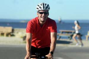 U.S. Rep. Jim Himes departs Compo Beach Park, in Westport, Conn. Sept. 3, 3021. Himes was joined by state legislators and community leaders Friday for the first leg of his bicycle tour north to the Massachusetts border.