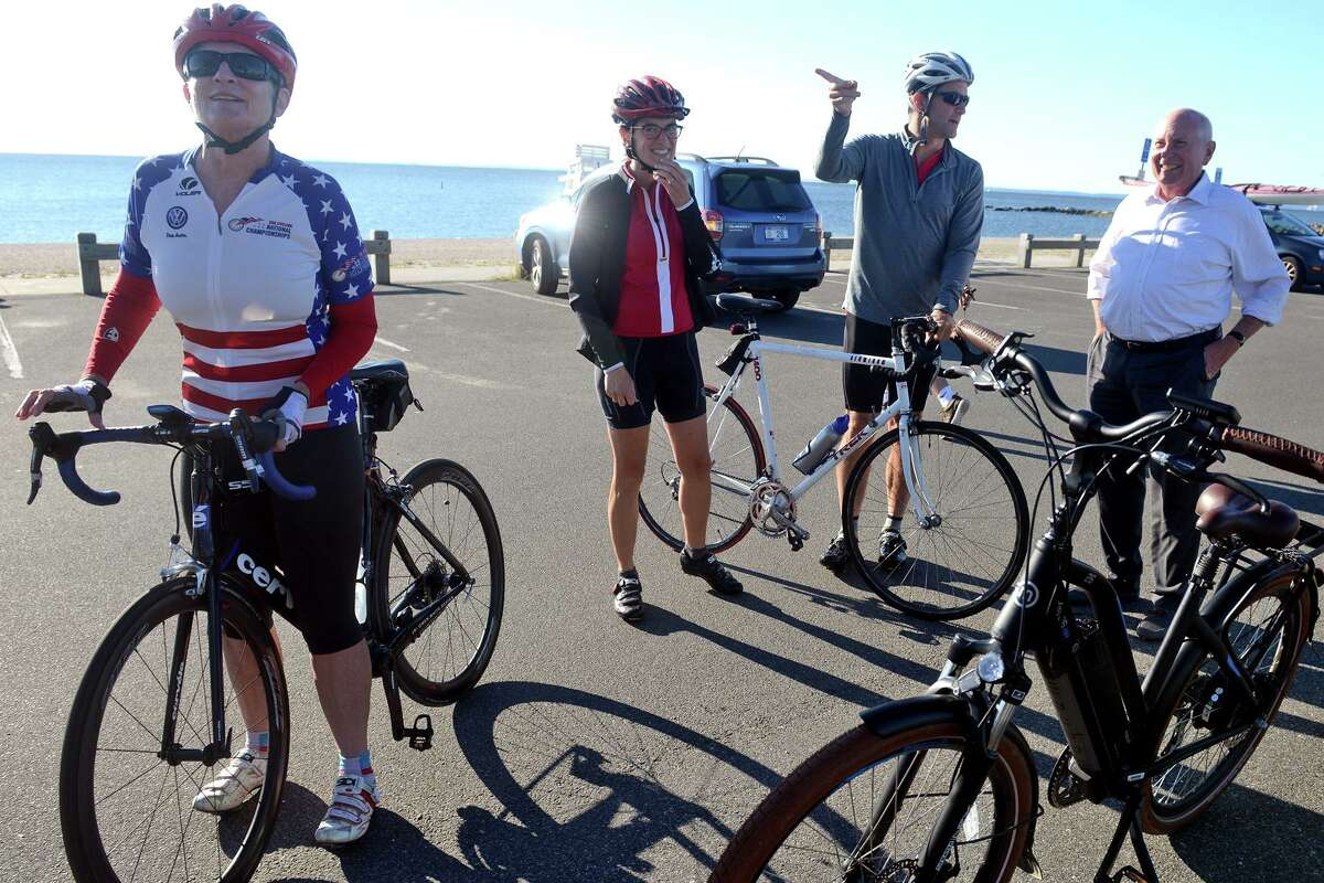 U.S. Rep. Jim Himes and others prepare to depart Compo Beach Park, in Westport, Conn. Sept. 3, 3021. Himes was joined by state legislators and community leaders Friday for the first leg of his bicycle tour north to the Massachusetts border.