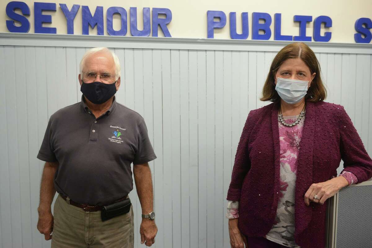 Susan Compton, Seymour's the new Superintendent of Schools, poses with Edward Strumello, Chairman of the Board of Education, in Seymour, Conn. Sept. 2, 2021.
