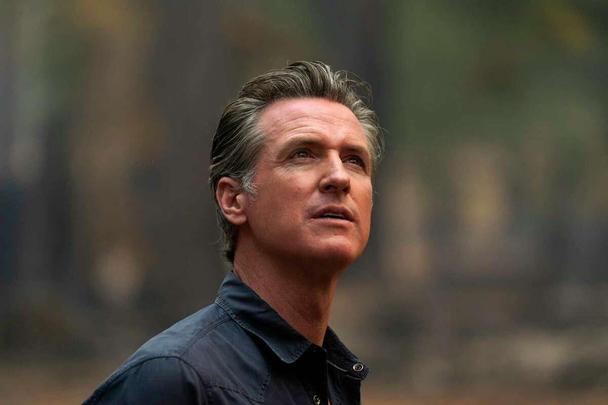 Gov. Gavin Newsom, who is facing recall, tours the area scorched by the Caldor Fire in Eldorado National Forest.