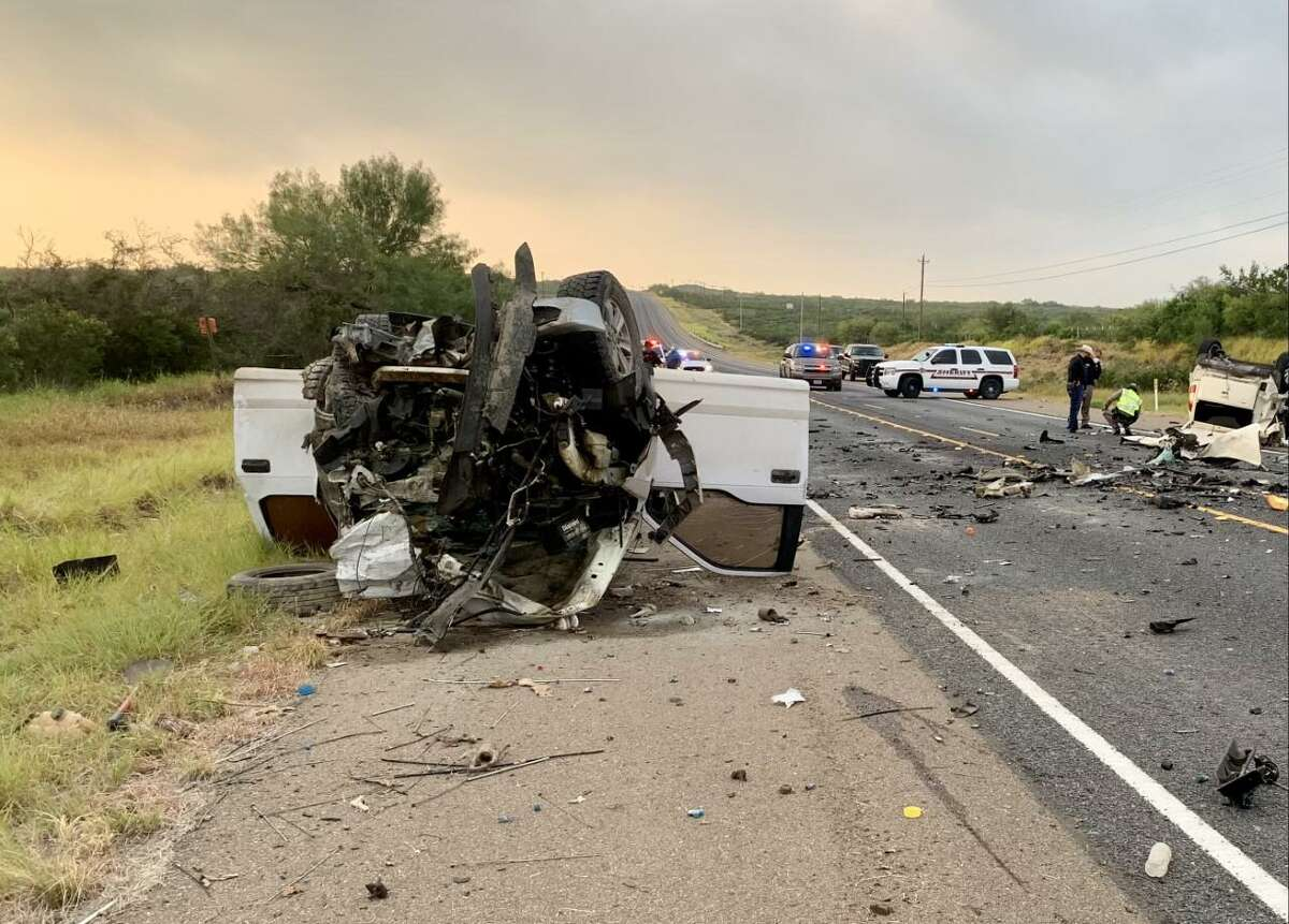 Authorities can be seen investigating a two-vehicle crash that claimed the life of a woman about 4 miles north of Zapata on Friday morning.