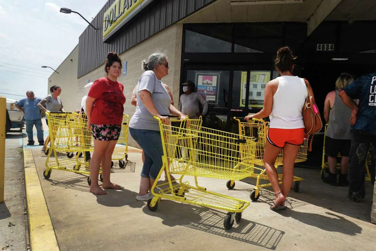 People wait in line to buy supplies on Aug. 31 in in Houma, Louisiana. The Friendswood Police Department is conducting a supply drive to help the Houma Police Department.