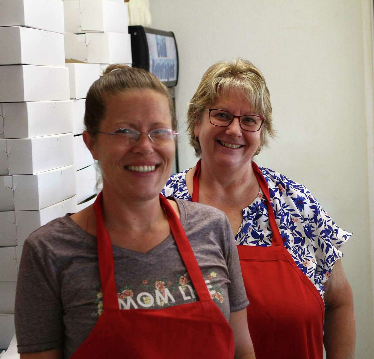 VanBrocklin's Bakery assistant Marla Kosinski (left) and owner Lynne VanBrocklin smile behind the counter on Thursday morning. (Pioneer photo/Joe Judd)