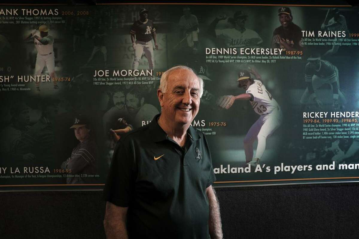 Steve Vucinich, A's equipment manager, in front a mural of former team greats in the club house at the Oakland Coliseum in Oakland, Calif., on Monday, April 3, 2017. Vucinich is entering his 50th season with the team, he started as a 15-year-old clubhouse attendant in 1968 when the A's first arrived in Oakland.
