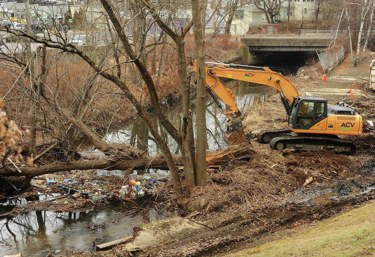 Debris is being removed from the Rooster River in Mountain Grove Cemetary in Bridgeport, Conn. on Thursday, December 20, 2018 to aid water flow in the wake of major flooding on September 25.