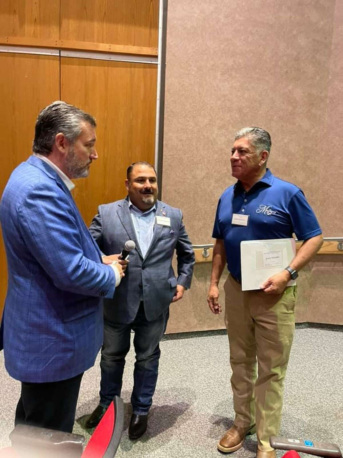 U.S. Sen Ted Cruz (left) talks with co-host Adrian Carrasco and former Midland Mayor Jerry Morales on Thursday.