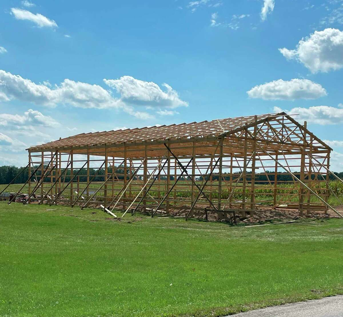 Men from the community gathered this week to work on Dustin's pole barn after the recent storm damage. (Courtesy photo)