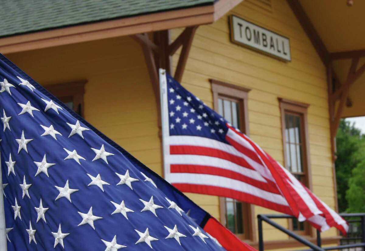 American flags fly outside the Depot in Tomball.