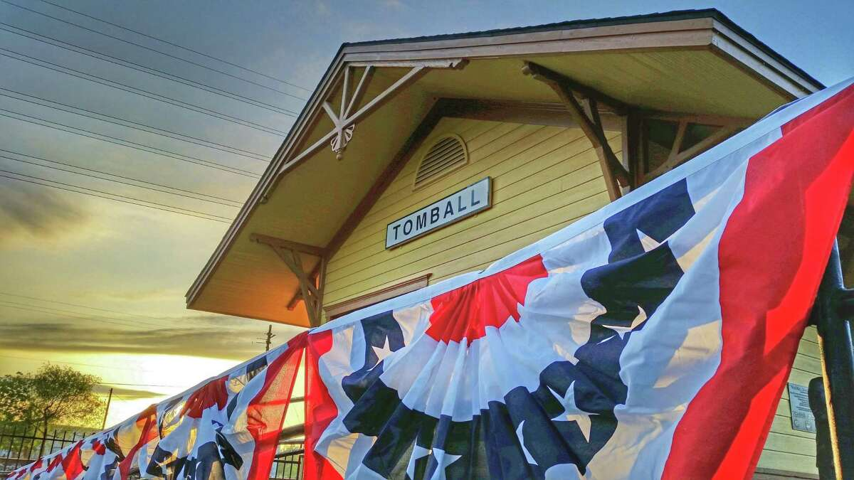 Patriotic bunting decorates the front of the Depot in Tomball.