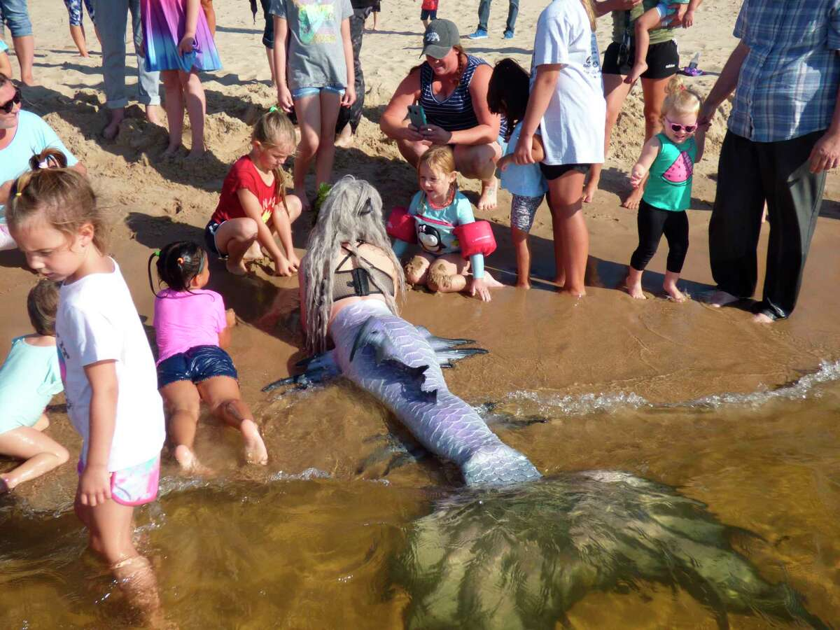 Mermaid Phantom,Brittany Adams,entertains young children at Manistee's First Street Beach on Sept. 2. (Courtesy photo/Courtney Fraley)
