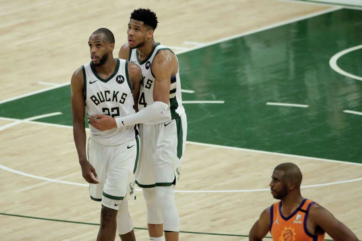 Giannis Antetokounmpo (right) and running mate Khris Middleton led Milwaukee to its first NBA championship in 50 years and the Bucks remained stacked to make a strong bid at a repeat.