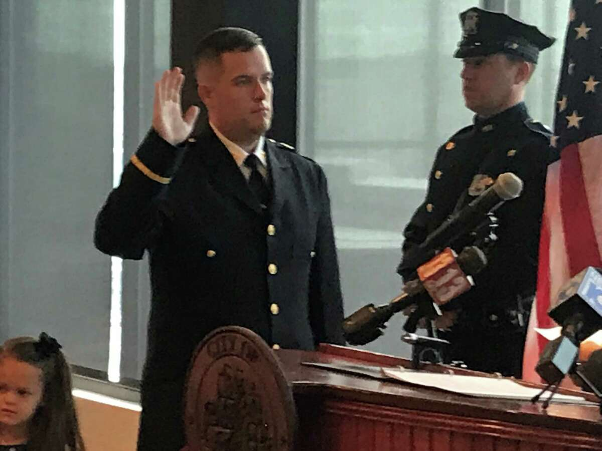 Troy Police Captain Steven Barker takes the oath of office to become the Troy Police Department's new assistant police chief on Friday, Sept. 3, 2021 at the Hedley Building, 433 River St., Troy, N.Y.