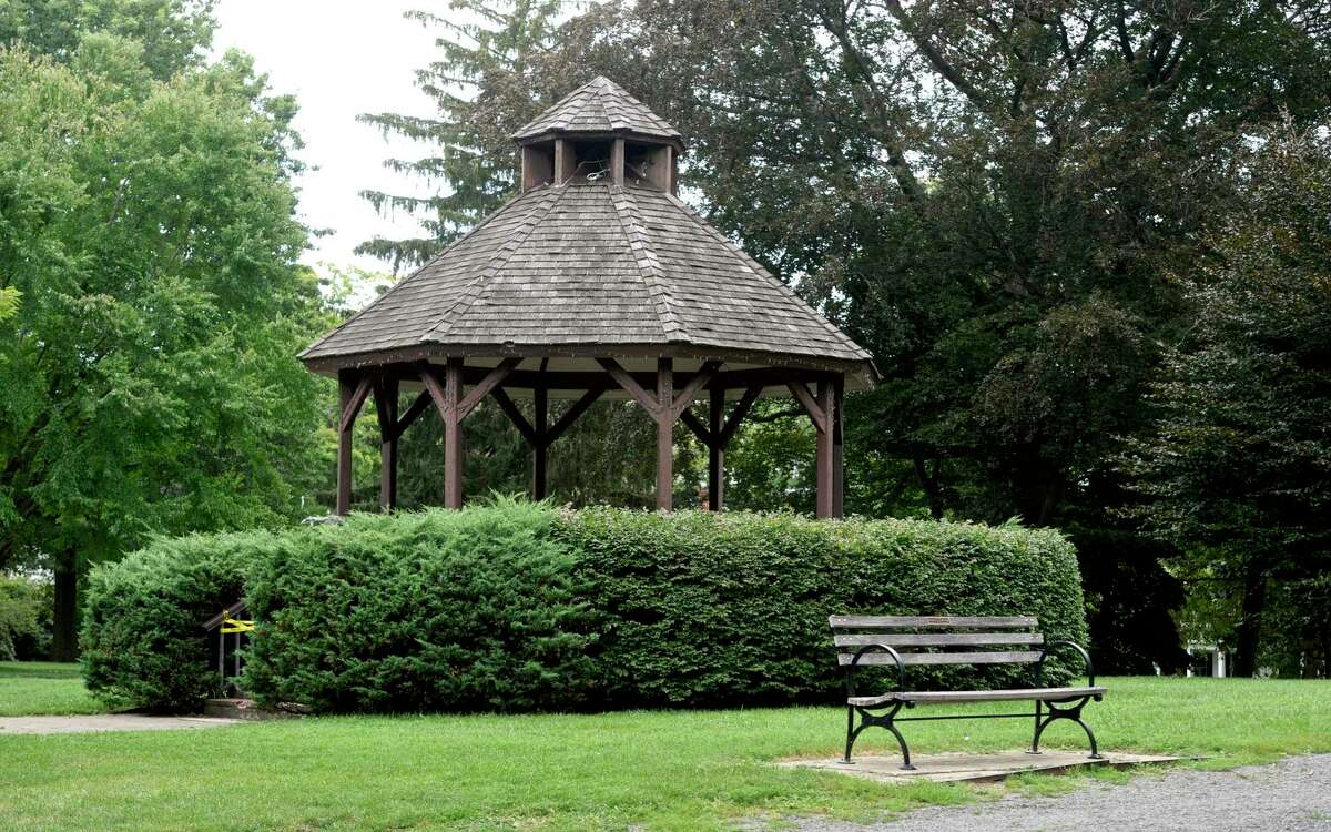 The bandstand in Ballard Park, which Darlene Flagg helped erect, includes a memorial stone in Flagg's name in the walkway. Flagg was a passenger on Flight 77 on Sept. 11, 2001. Friday, August 20, 2021, in Ridgefield, Conn.