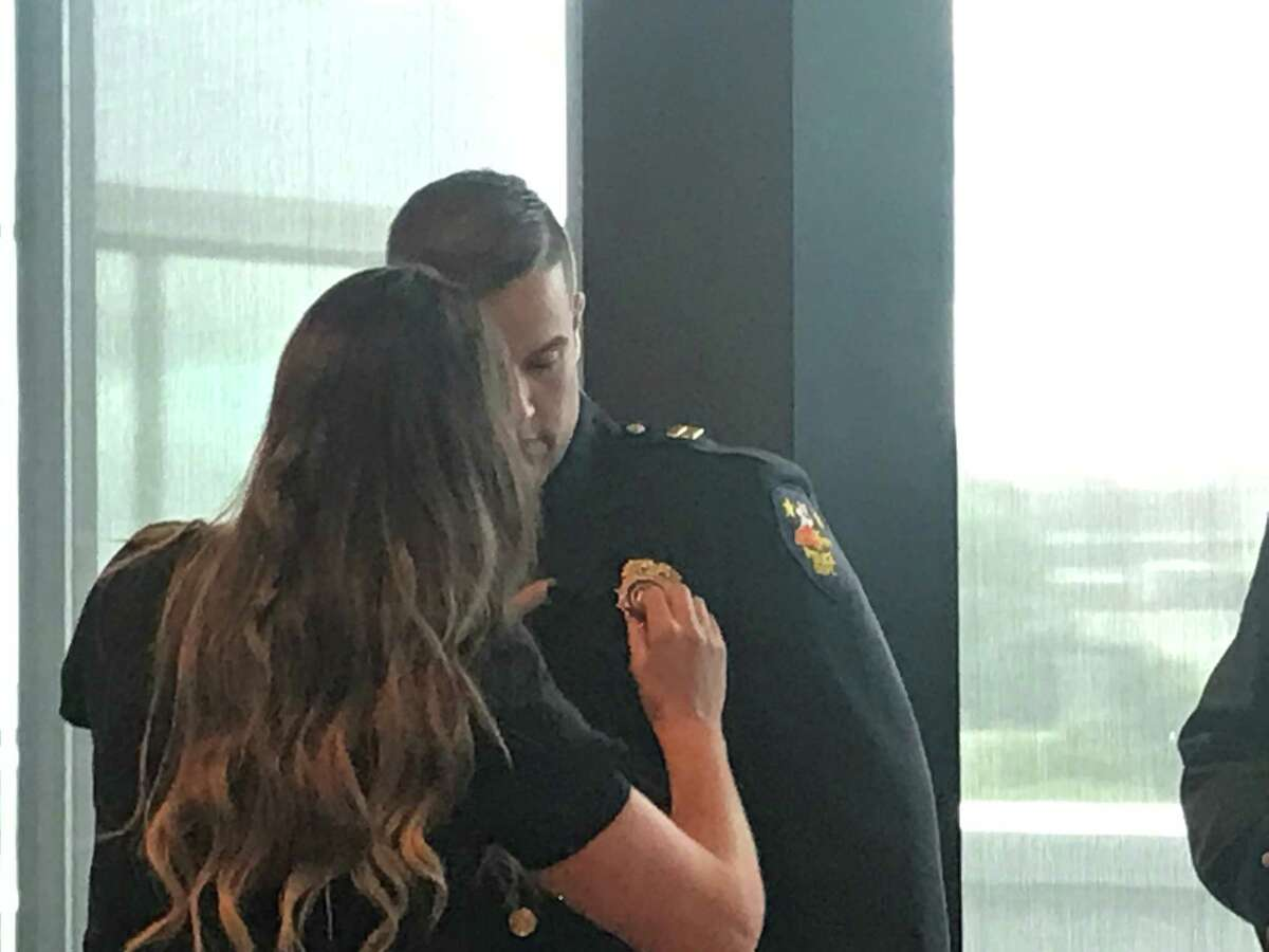 Adrienne Barker pins the assistant chief badge on her husband, the new Troy Police Assistant Chief Steven Barker after he was sworn in on Friday Sept. 3, 2021 at the Hedley Building, 433 River St., Troy, N.Y.