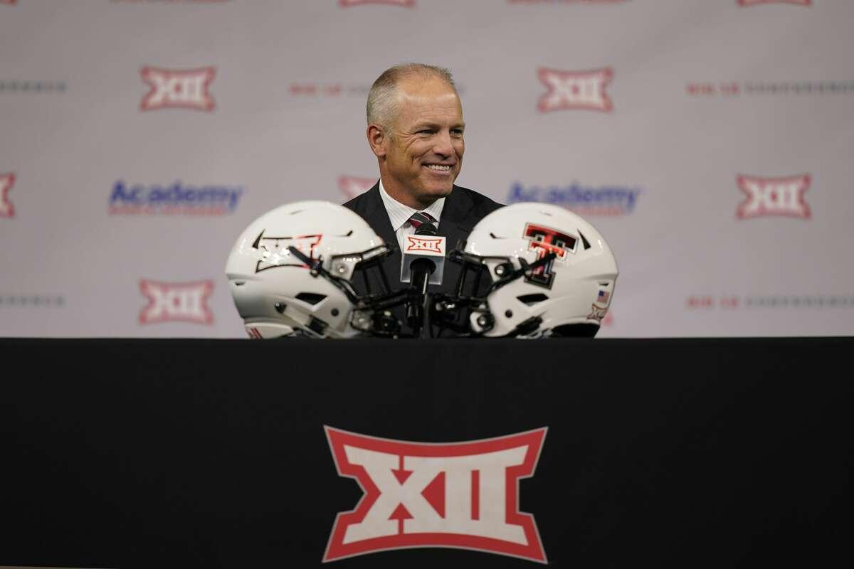 Texas Tech head coach Matt Wells smiles before speaking at the college football Big 12 media days Thursday, July 15, 2021, in Arlington. (AP Photo/LM Otero)