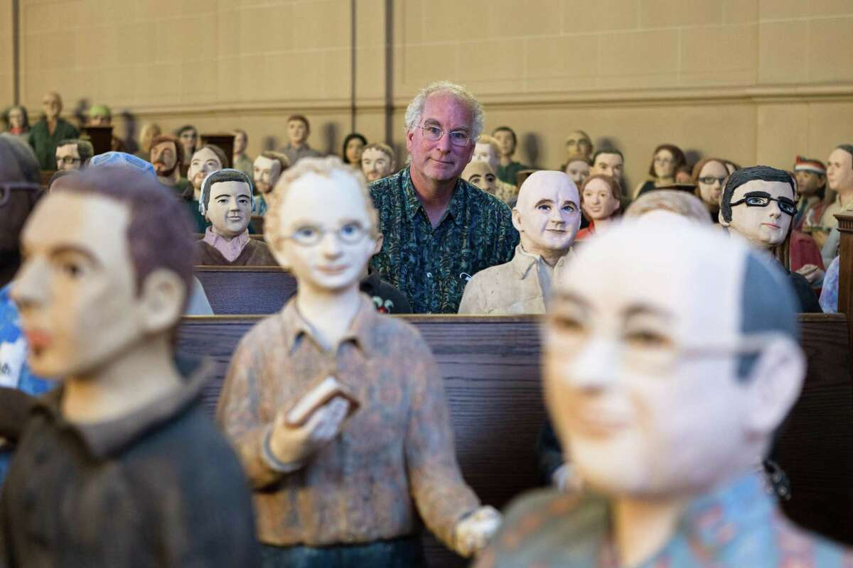 Internet Archive founder Brewster Kahle shows statues of the organization's staff.