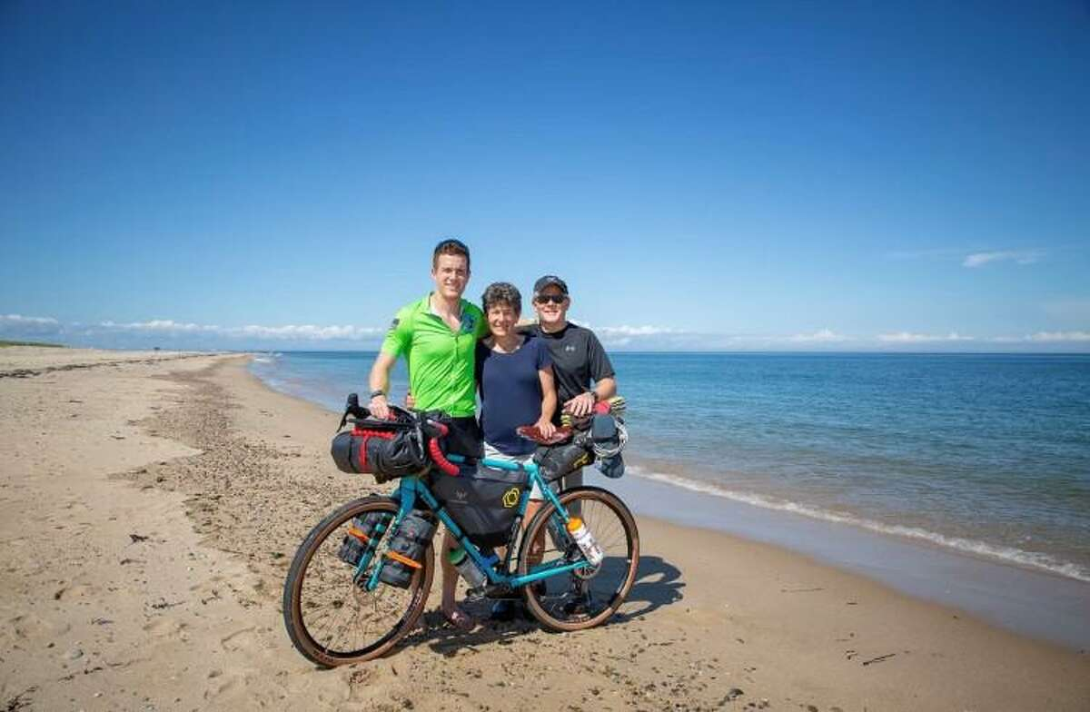 Ben Grannis posed with his parents Sandy and Roger before taking off on his cross-country bike trip last month. The family is pictured on Race Point Beach in Provincetown, Mass., where Grannis' journey began.