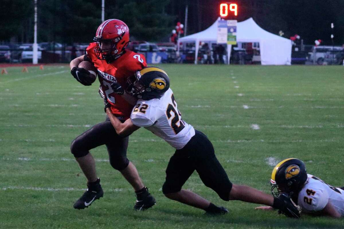 Nate Childers battles his way to the Huskies' only touchdown on Sept. 2. (Robert Myers/Record Patriot)