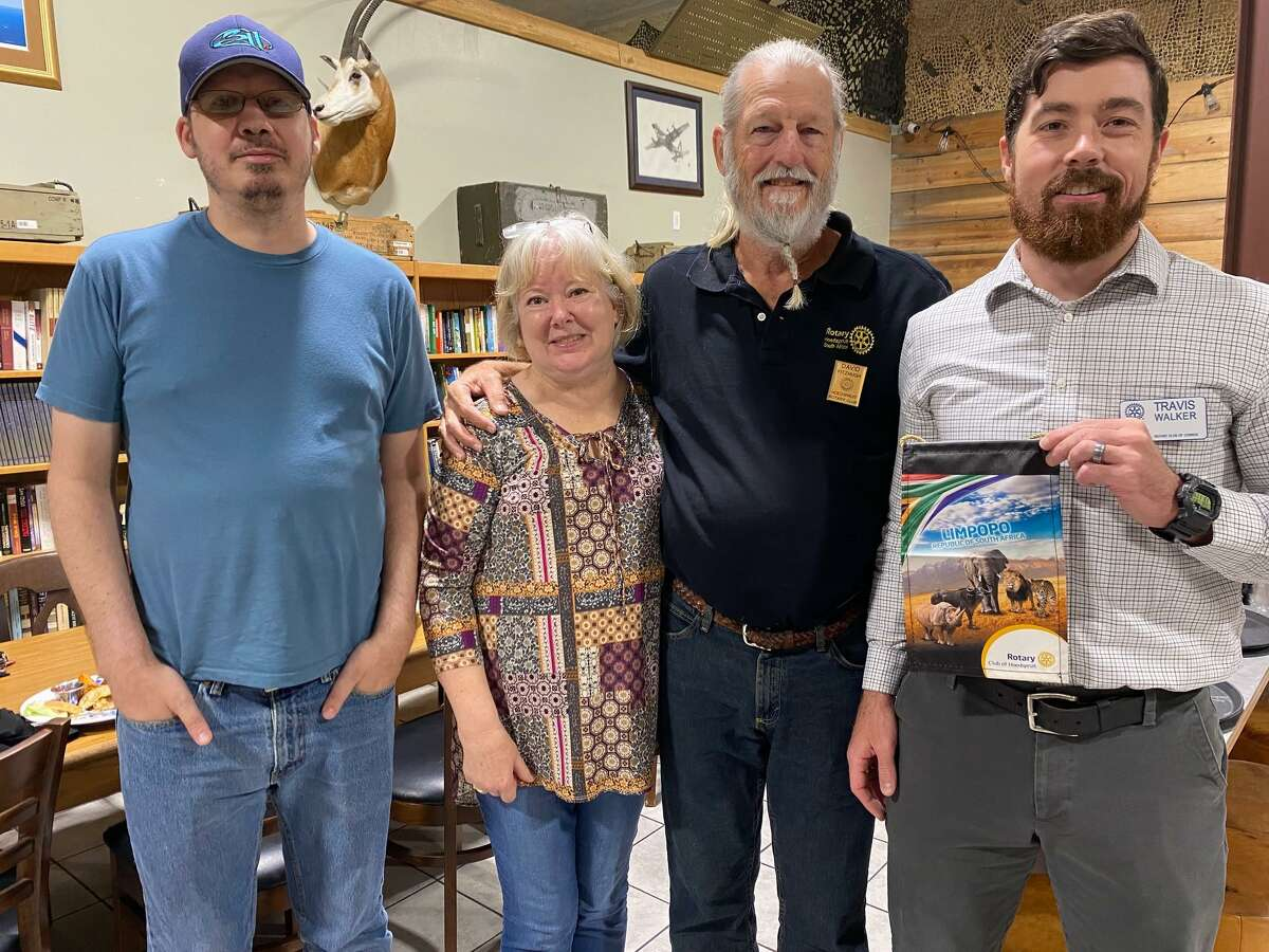 Pictured from left are Matt, Susan and David Fitzhugh with Rotary Club of Conroe president Travis Walker. The Fitzhughs used to live in Conroe but now live in South Africa. They were in town paying a visit to Conroe friends.