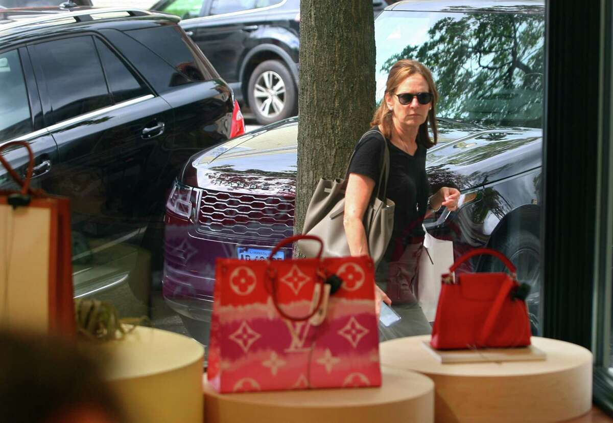 A passerby in August 2021 outside the new Rebag store on Greenwich Avenue in Greenwich, Conn. Retail hiring lagged several other sectors in the U.S. economy in August, with overall jobs gains at half the monthly average of the year to date.