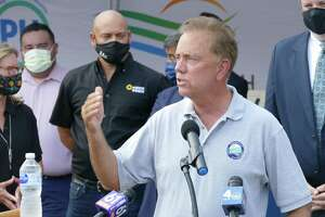 Gov. Ned Lamont speaks in late August 2021 outside a CTown grocery store in Danbury, Conn., urging state residents to get vaccinated who have yet to do so in ongoing efforts to keep COVID-19 in check.