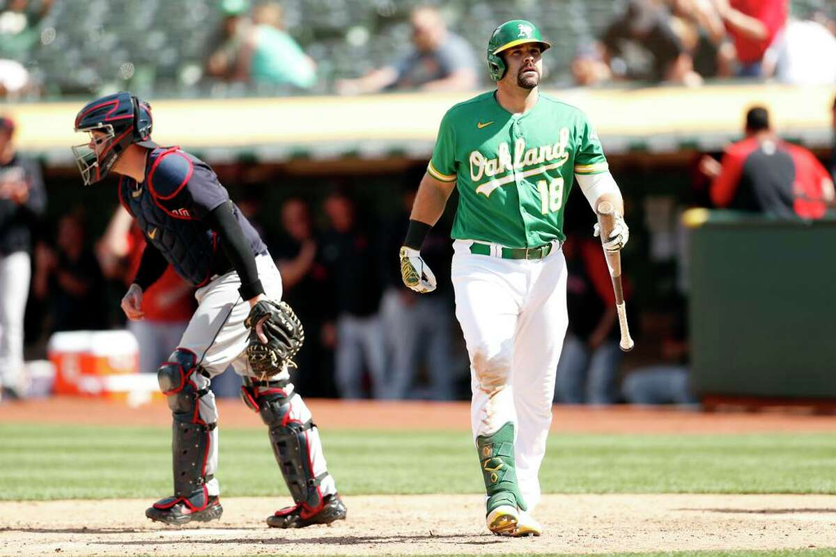 Oakland Athletics' Mitch Moreland strikes out to end 4-2 loss to Cleveland Indians in MLB game at Oakland Coliseum in Oakland, Calif., on Sunday, July 18, 2021.