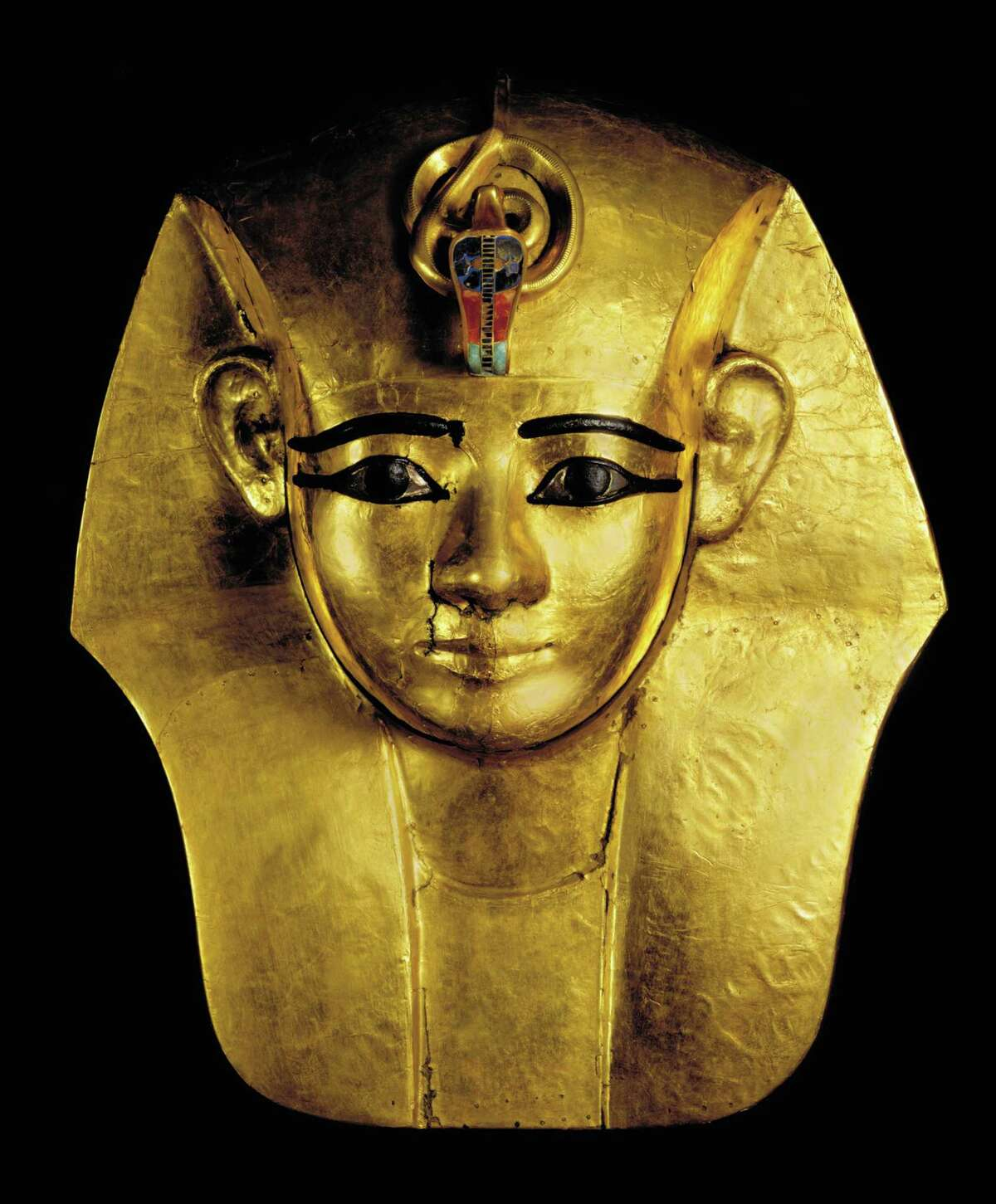"""Gold Mask from king's Wooden Coffin- Inlaid Uraeus from """"Ramses the Great and the Gold of the Pharaohs."""" The exhibition is created by Cityneon, an entertainment experience company, with the Supreme Council of Antiquities of the Arab Republic of Egypt, World Heritage Exhibitions and the Houston Museum of Natural Science."""