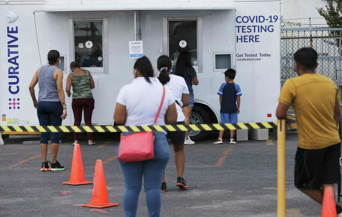 People wait in line to get tested for COVID-19 at the Curative mobile testing site at the American Legion Alamo Post #2 on Fredericksburg Road on Friday, Sept. 3, 2021.