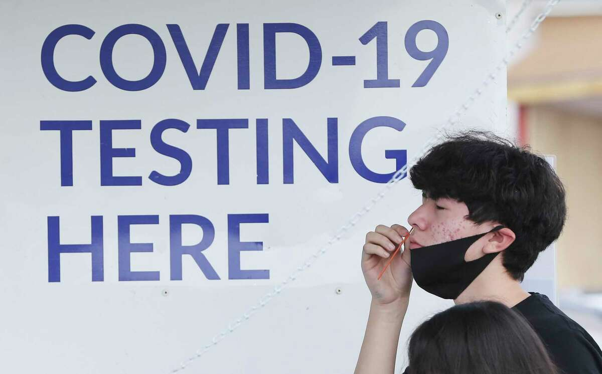 Fabian Cedillo, 16, performs a self-swab to test for COVID-19 at the Curative mobile testing site at the American Legion Alamo Post #2 on Fredericksburg Road on Friday, Sept. 3, 2021.