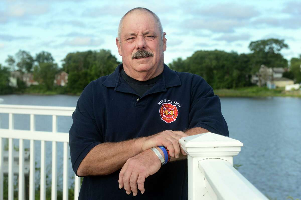 Lt. Dave Russell, a member of the FDNY and Fairfield native, poses near his home in Bridgeport.
