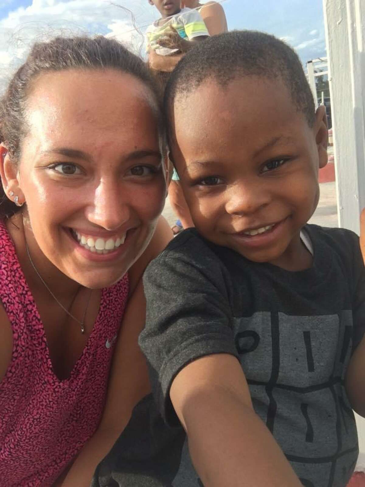 Torrington native Angelica Mourges lives and works in a mountain town in Haiti, where she is the education director of a school, Academie Brezou. She is pictured with Robensley, her sponsored child, whom she traveled to visit in Haiti before becoming a teacher there.