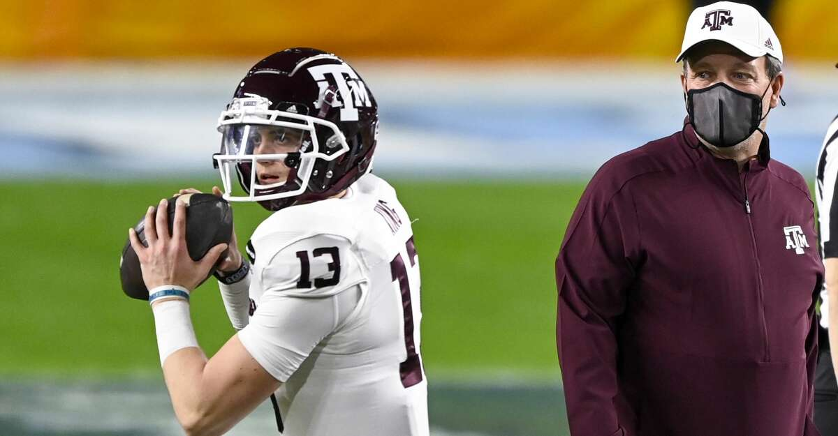 Texas A&M Aggies head coach Jimbo Fisher watches Texas A&M Aggies quarterback Haynes King (13) throw the ball on the field before the Capital One Orange Bowl college football game between the Texas A&M Aggies and the North Carolina Tar Heels on January 2, 2021 at the Hard Rock Stadium in Miami Gardens, FL. (Photo by Doug Murray/Icon Sportswire via Getty Images)