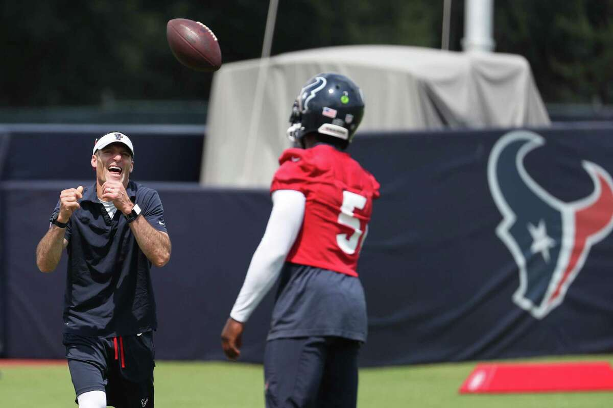 Houston Texans quarterback Tyrod Taylor, tossing the ball to Nick Caserio during training camp, was the general manager's most-expensive signing in free agency but still at a bargain price.