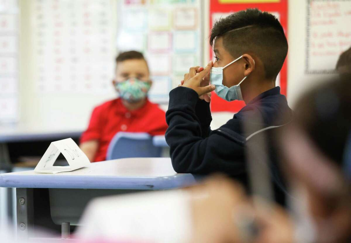 A student listens as Claudia Talavera teaches her first-grade class during the first day of classes in Houston Independent School District on Monday, Aug. 23, 2021, at Memorial Elementary School in Houston.