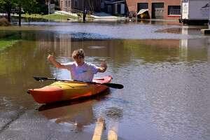 New Milford resident Matt Batista kayaked over flood waters last Thursday in Danbury.