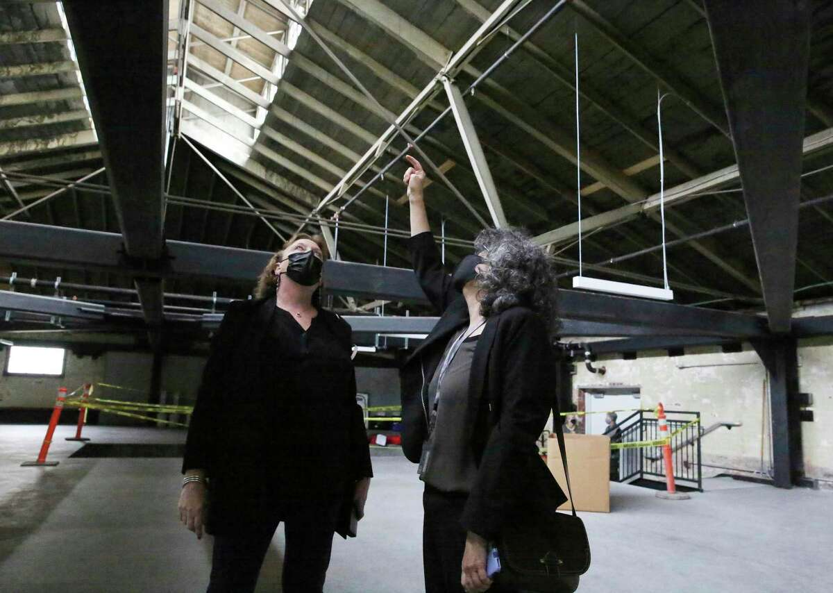 Principal architect Julia Laue (left) and lead designer Patty Solis look around a room on the roof that's not in use yet at the new San Francisco Animal Care & Control center.