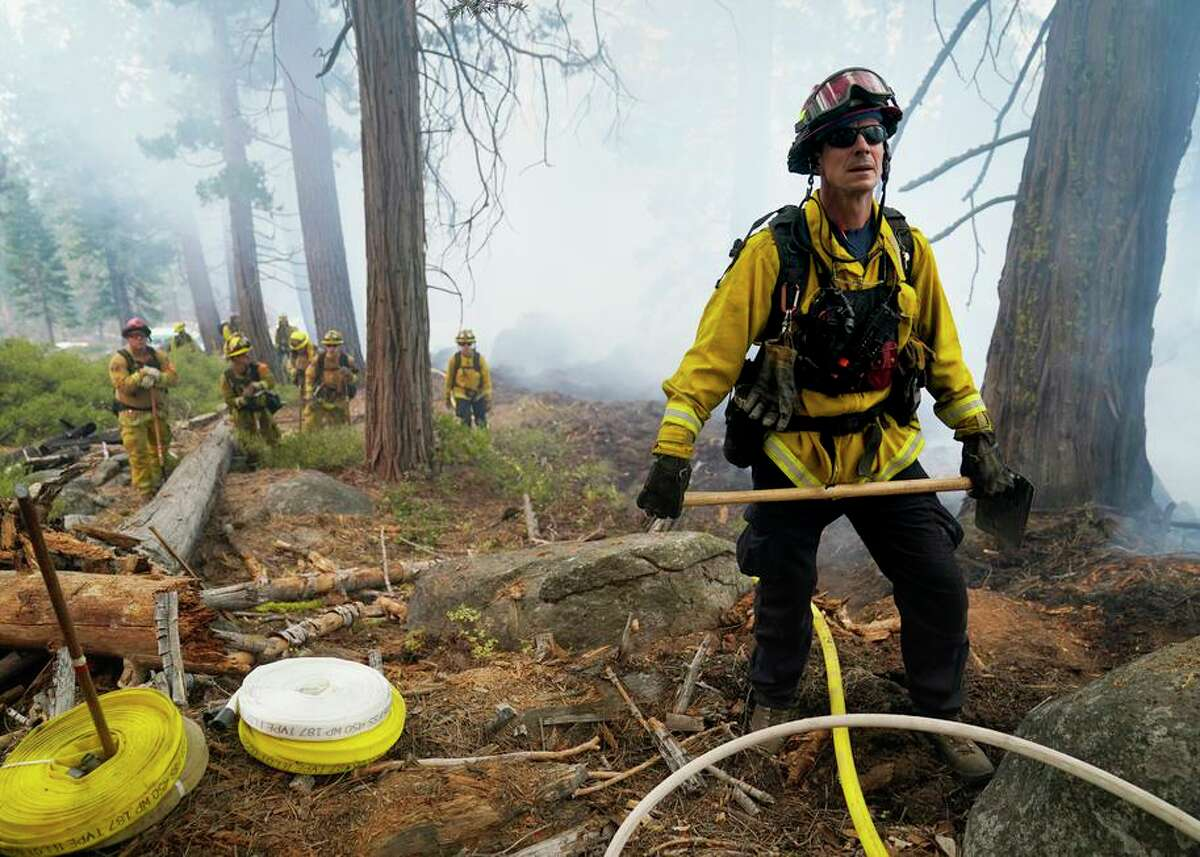 Will Fitch, fire captain from Cosumnes Fire Department, and his crew hold a line to keep the Caldor Fire from spreading.