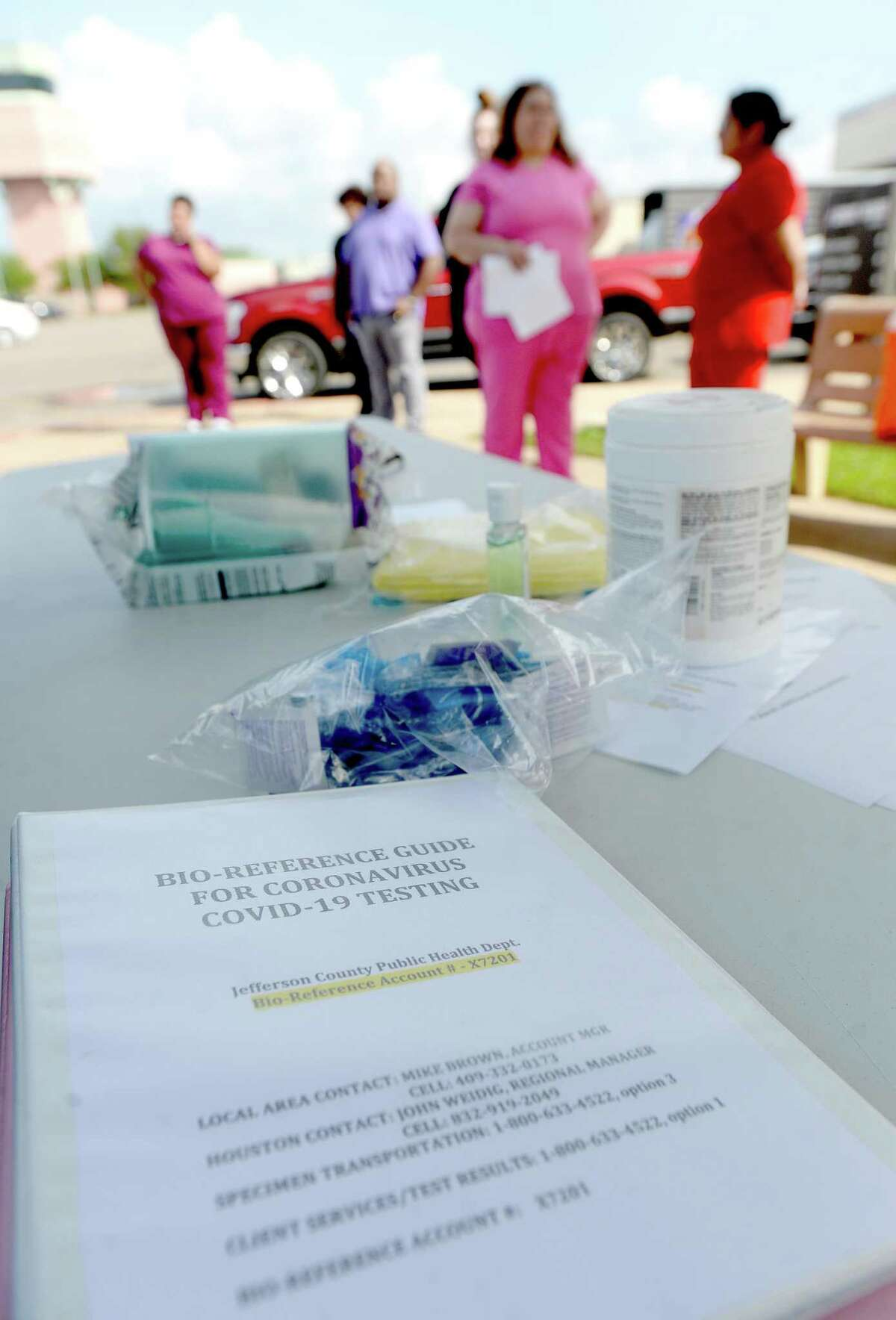 A guide for testing sits on a table as medical personnel gather with representatives from multiple Southeast Texas counties annnounce the opening of a drive-thru testing unit for COVID-19 at Jack Brooks Regional Airport Monday. Photo taken Monday, March 23, 2020 Kim Brent/The Enterprise